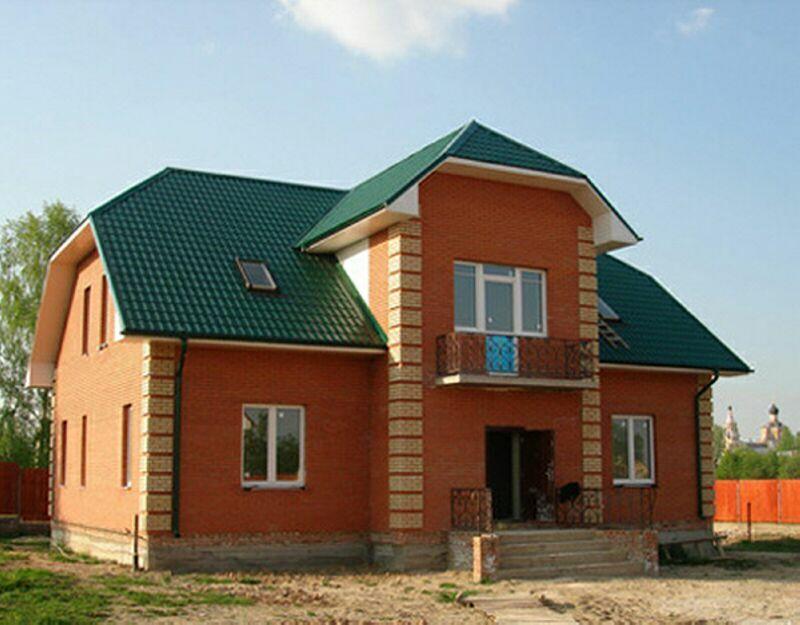 Кирпичные дома и коттеджи фото